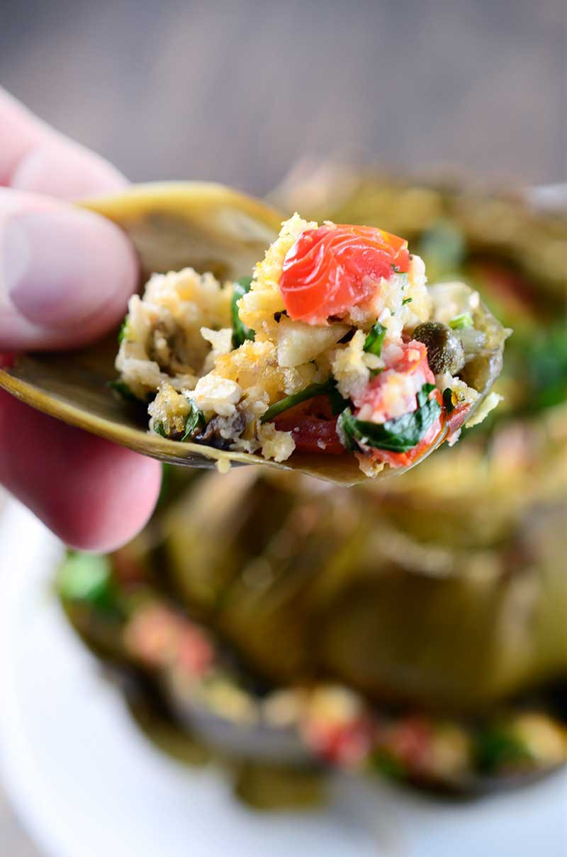 Artichokes loaded with kalamata olives, garlic, olive oil, parsley, oregano, bread crumbs, tomatoes, feta and capers make these Greek Stuffed Artichokes a gorgeous way to welcome spring!