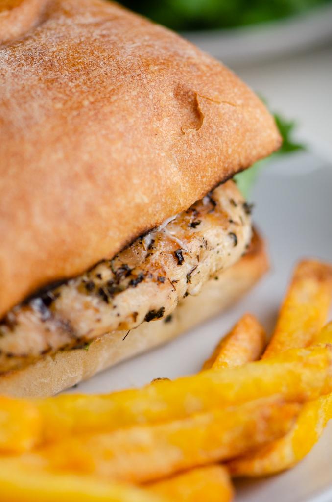 Close up side photo of chicken sandwich.