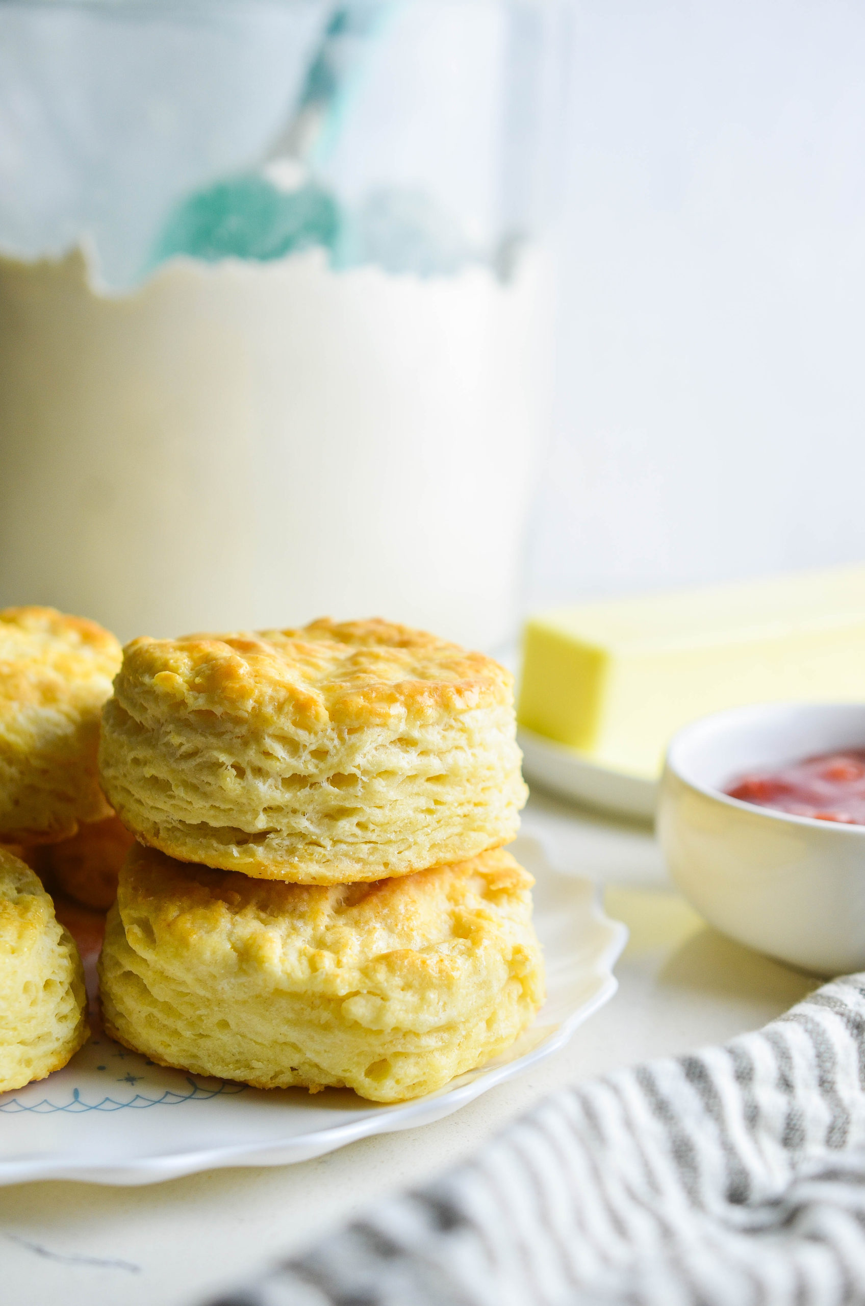 Two buttermilk biscuits staked on top of each other.