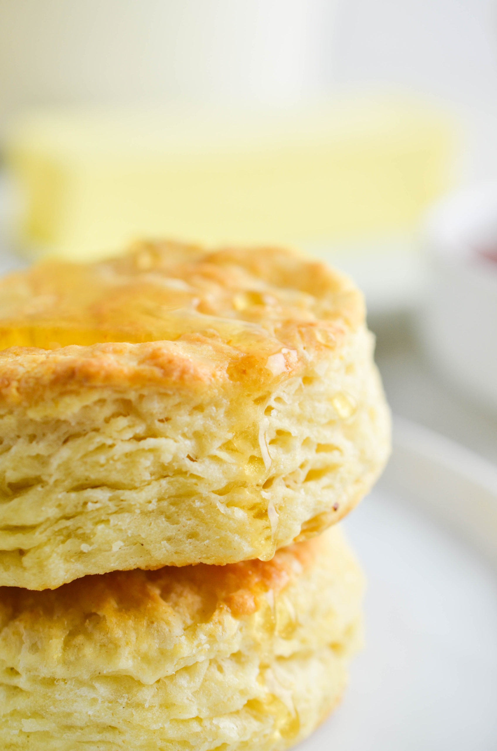 Up close photo of biscuit with honey drizzle.