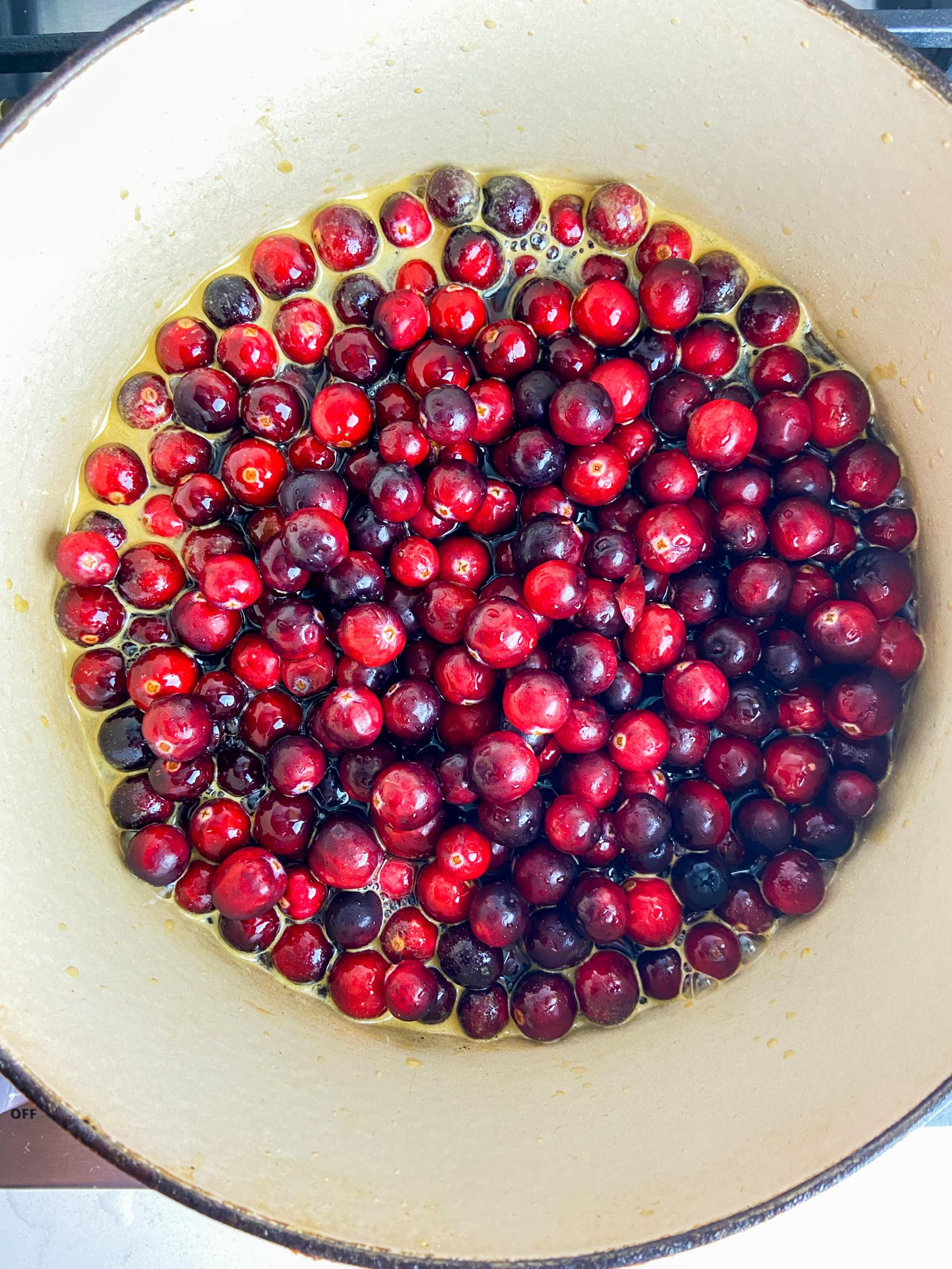 Overhead photo of cranberries in pot.