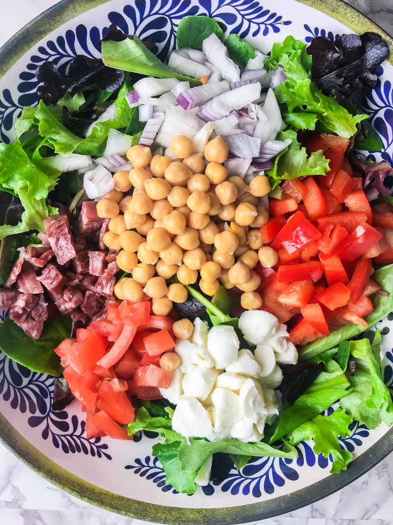 Italian chopped salad LOADED with salami, mozzarella and veggies all tossed in a tangy balsamic dijon vinaigrette.
