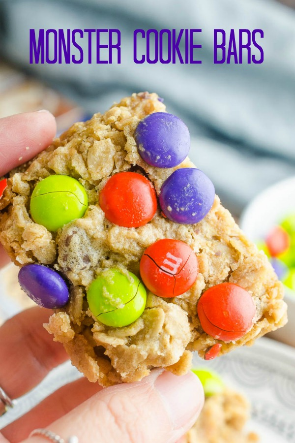 Easy and chewy Monster Cookie Bars are a perfect afternoon treat for kiddos! Change out the colors of the M&Ms for all of your favorite holidays! #monstercookies #monstercookiebars #bars #dessert