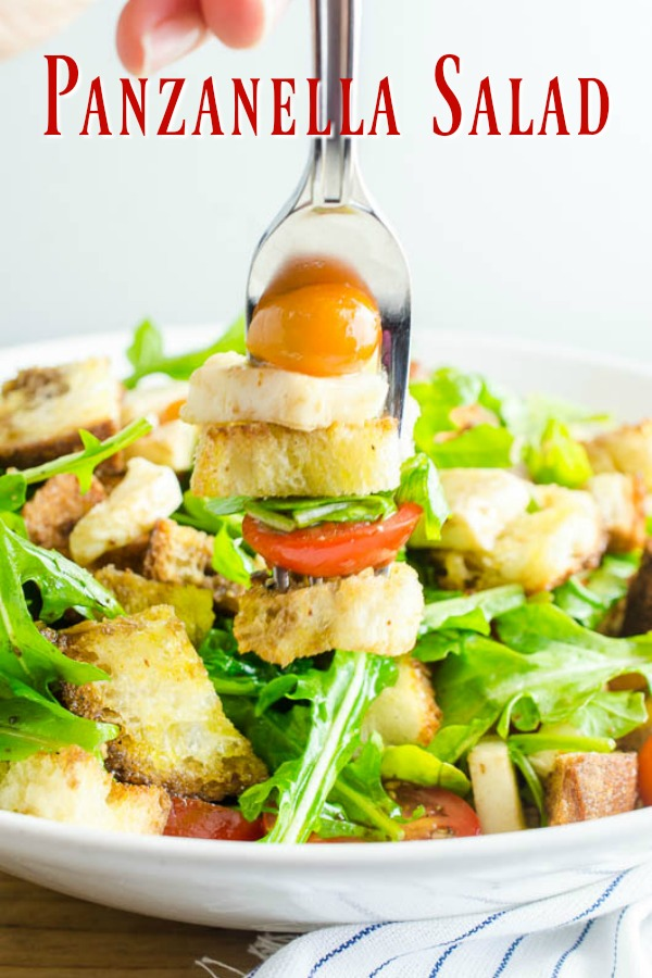 Panzanella Salad is a Tuscan salad with bread, tomatoes, herbs and a simple vinaigrette. It's the perfect way to enjoy summer tomatoes!  #vegetarian #salad #panzanella #italianfood #italianrecipe