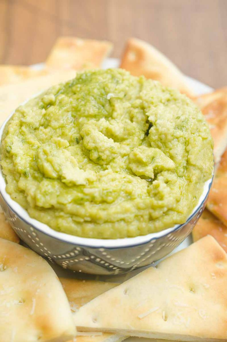 Pesto White Bean Dip gives a burst of summer to this classic Italian dip. It will be the perfect addition to summer parties and picnics.