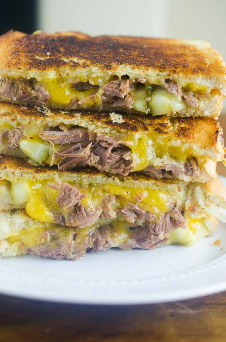 Pot Roast Grilled Cheese is THE BEST thing to do with your leftover Pot Roast. Loaded with cheddar, pot roast and pickles. It's leftover bliss!