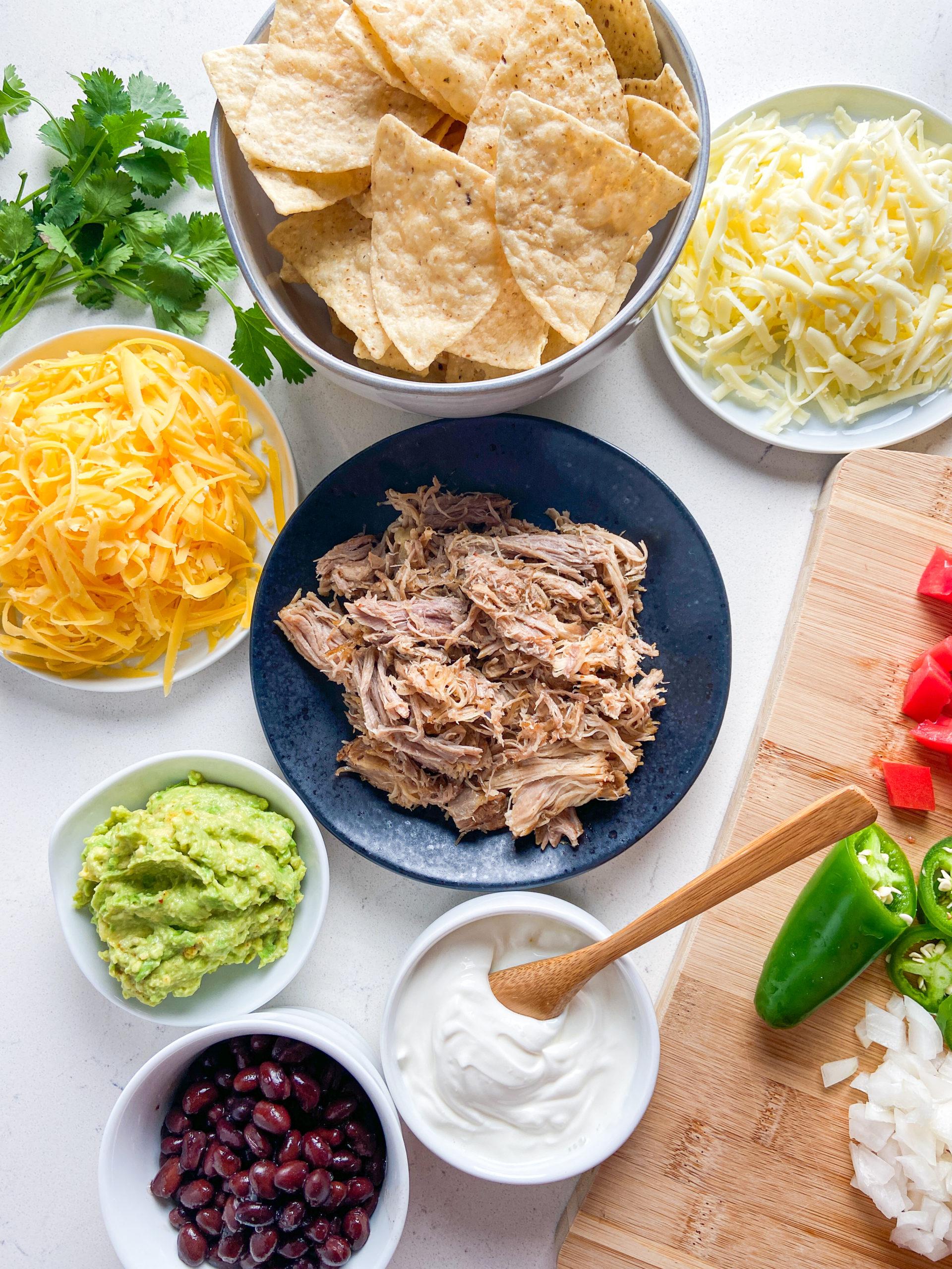 Overhead photo of ingredients  used to make pulled pork nachos.