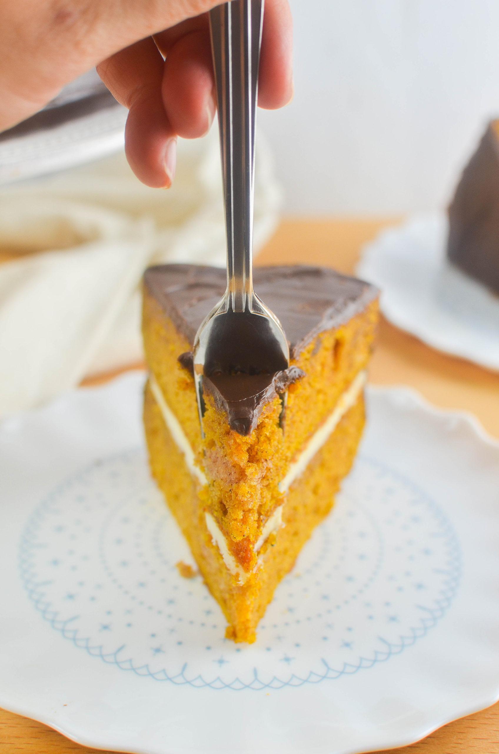 Fork taking a piece of pumpkin cake.