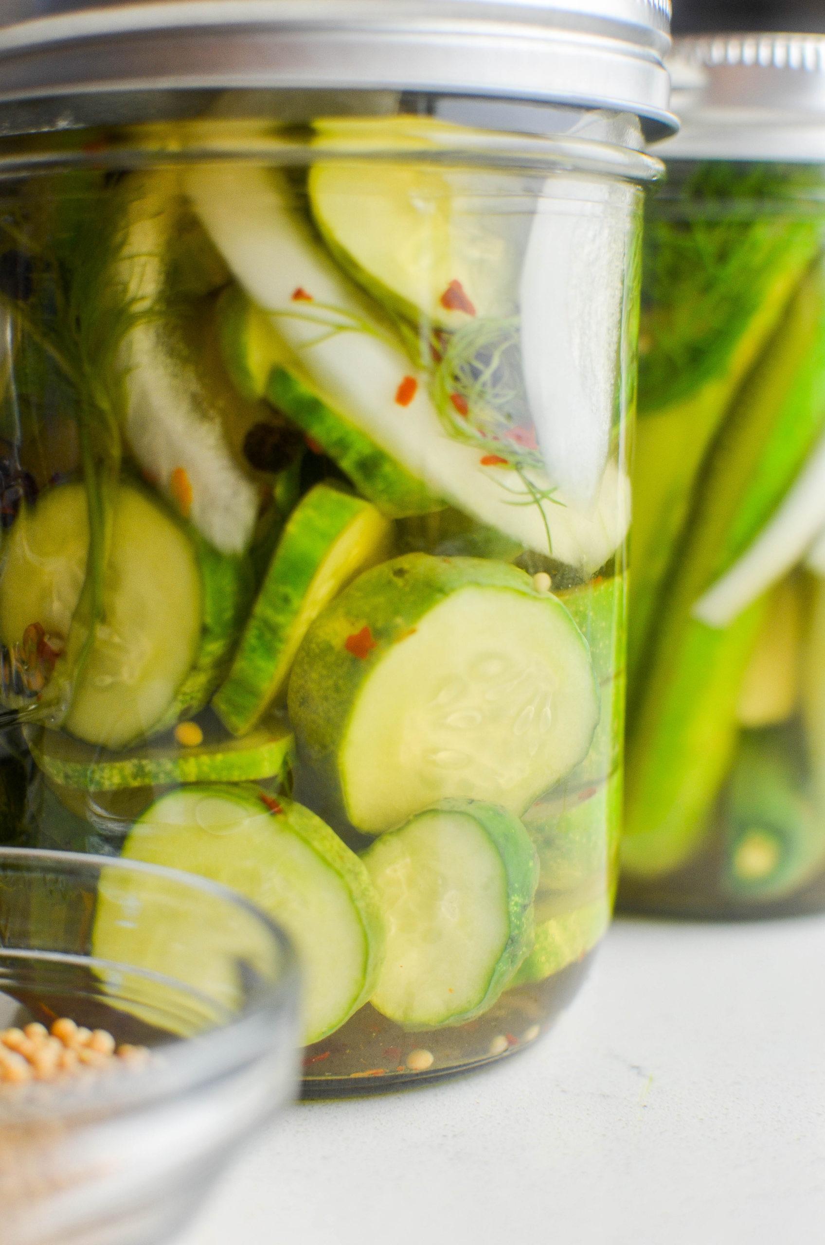 Refrigerator pickles in a glass jar.