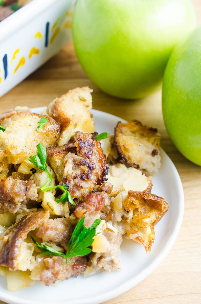 Sausage apple stuffing with brie on a plate.