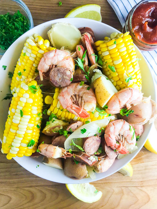 An easy shrimp boil recipe with shrimp, sweet corn, spicy andouille, and red potatoes. It's great for a crowd!