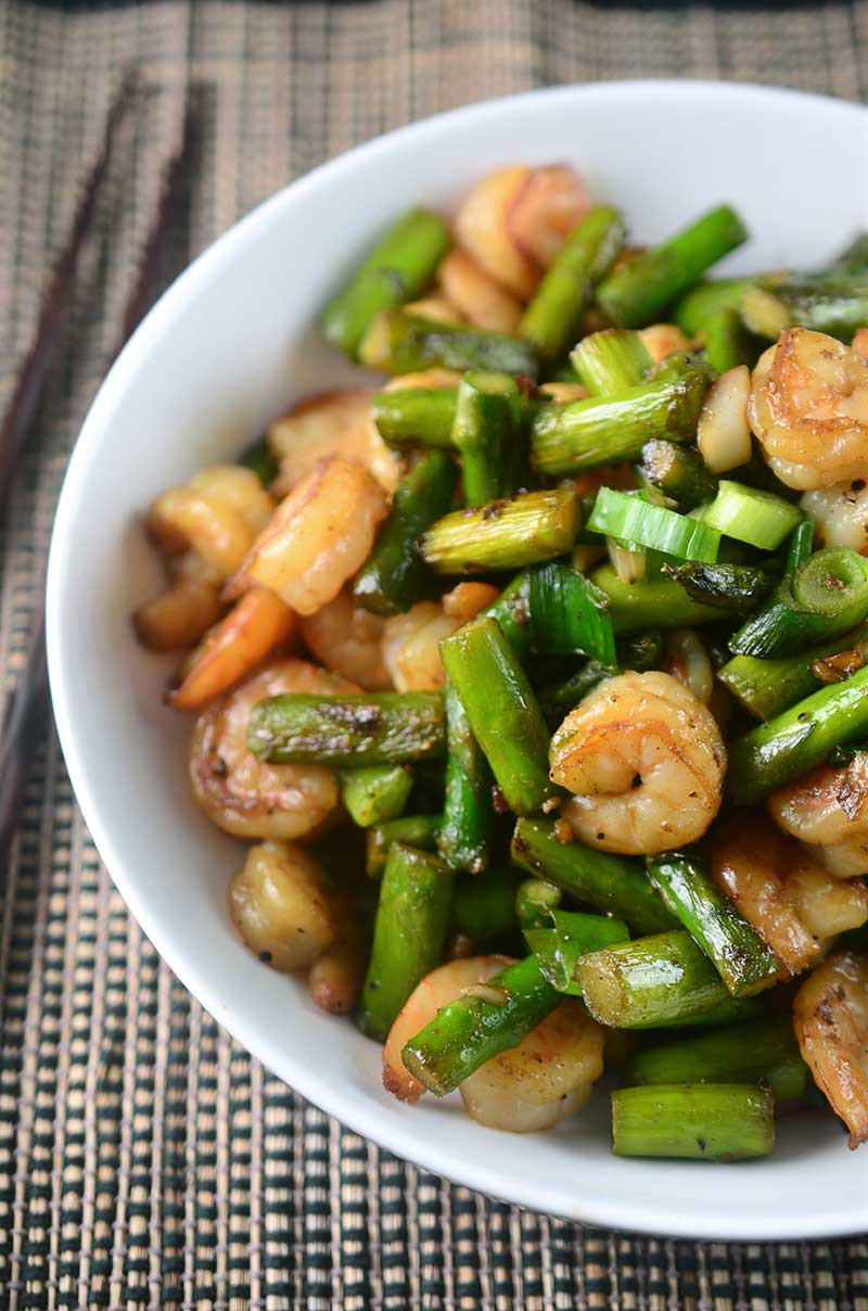 Welcoming asparagus season with this quick and easy Shrimp and Asparagus Stir Fry. It's perfect for weeknights and a total crowd pleaser.