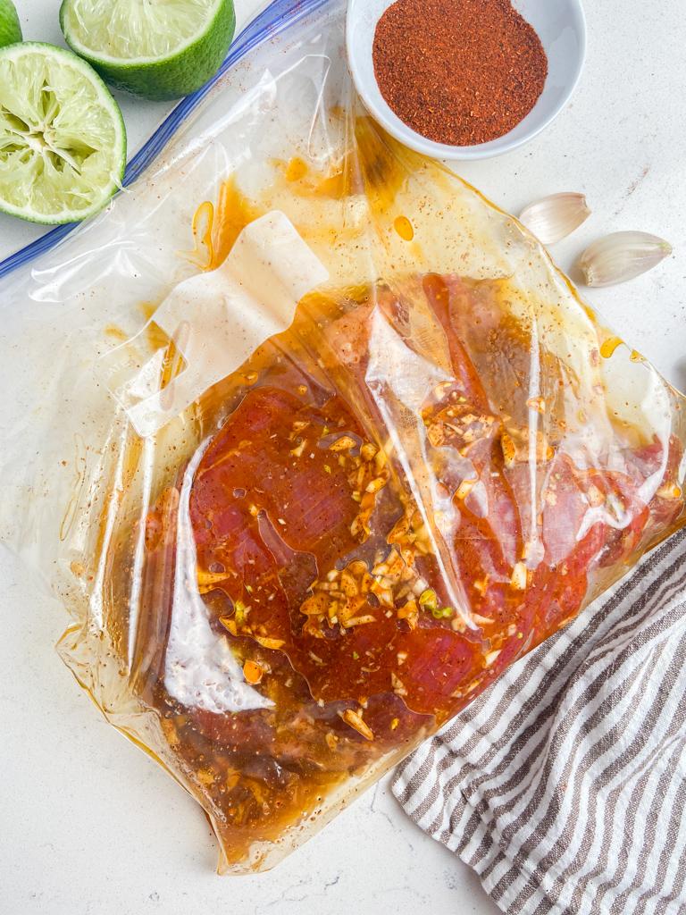 Steak marinating in a bag.