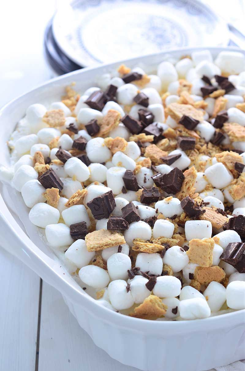 S'mores Oreo Icebox Cake is a THEE dessert that you need to be making this summer. Loaded with s'mores oreos, whipped cream, marshmallows, graham crackers and chocolate.