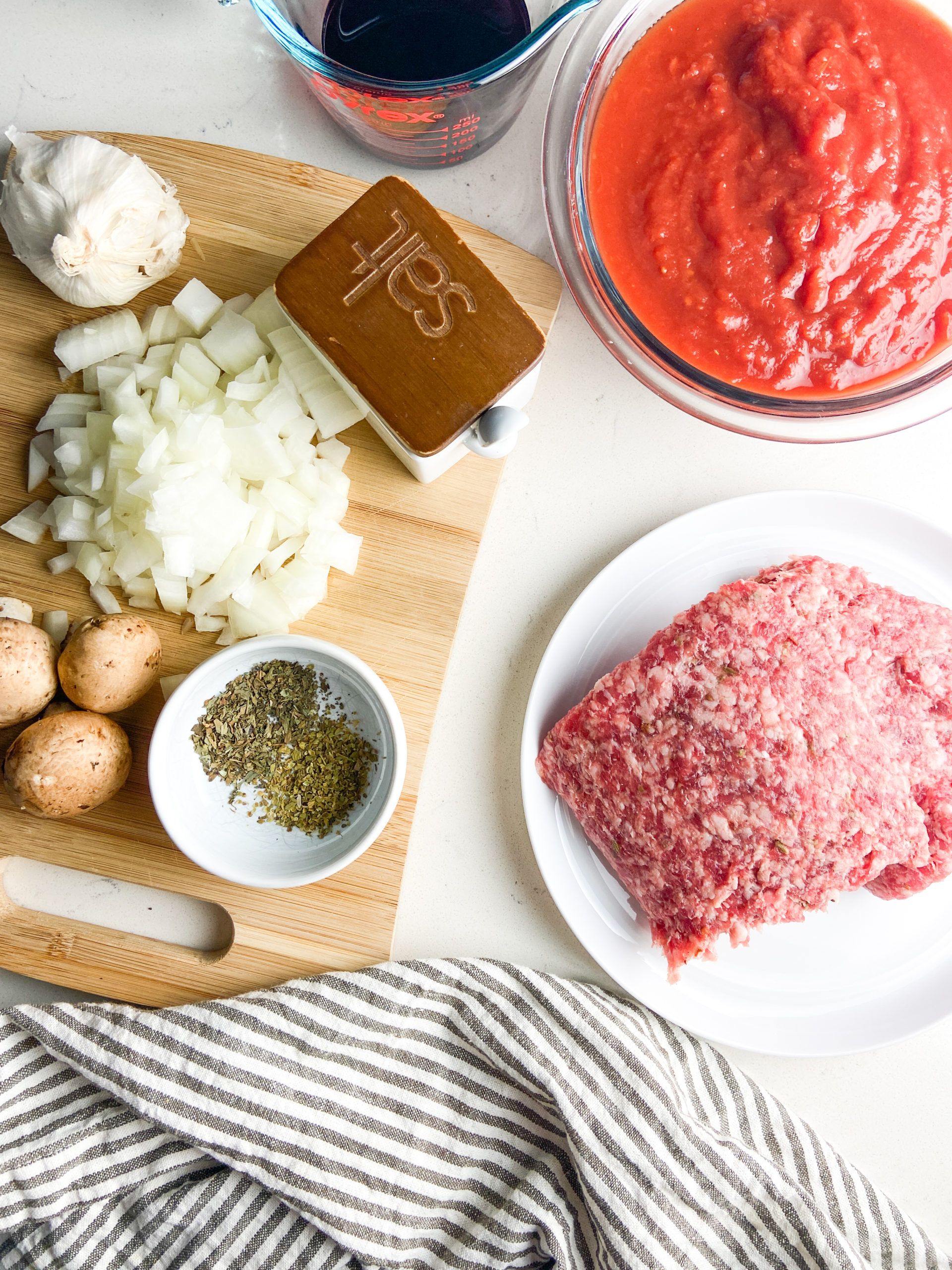 Overhead photo of ingredients for spaghetti with meat sauce.