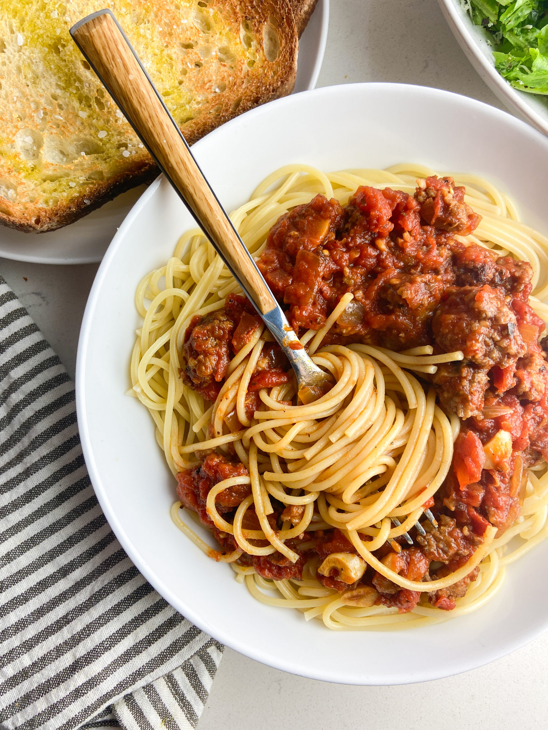 Overhead photo of a fork twirling spaghetti