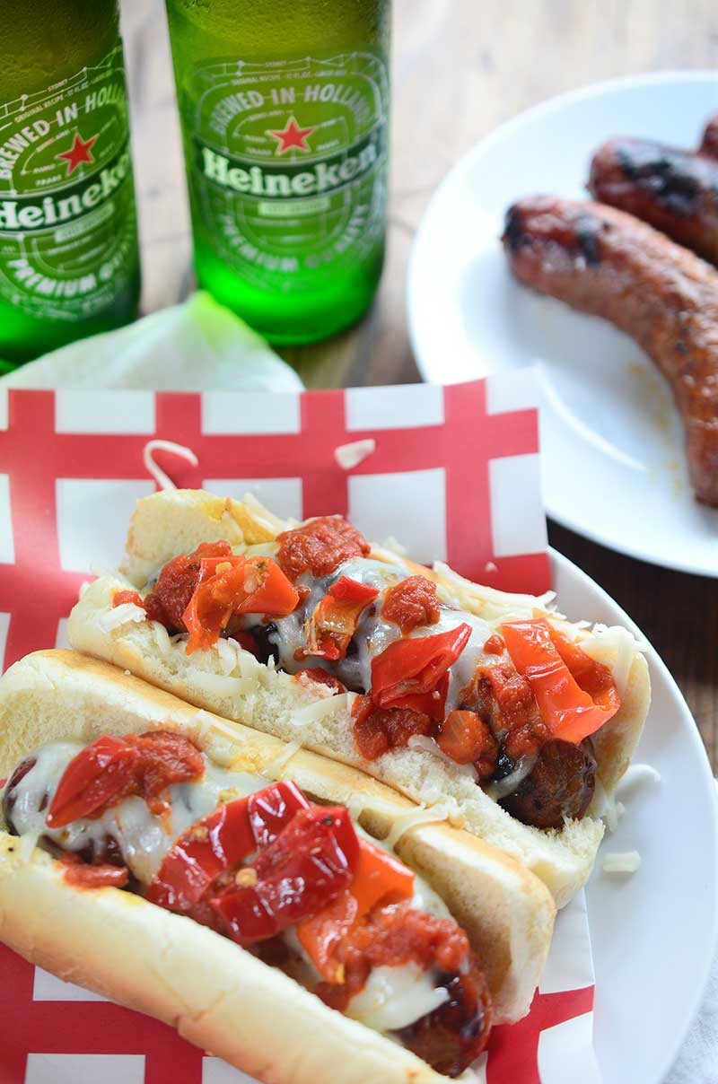 Spicy Italian Sausage Dogs topped with mozzarella, marinara and spicy peppers are the perfect spicy grilled meal this summer.