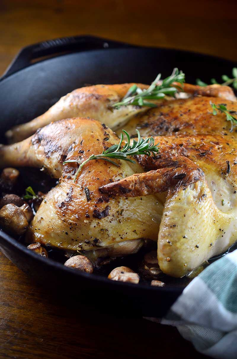 Learn how to spatchcock a chicken and make this Summer Savory Spatchcocked Chicken recipe!