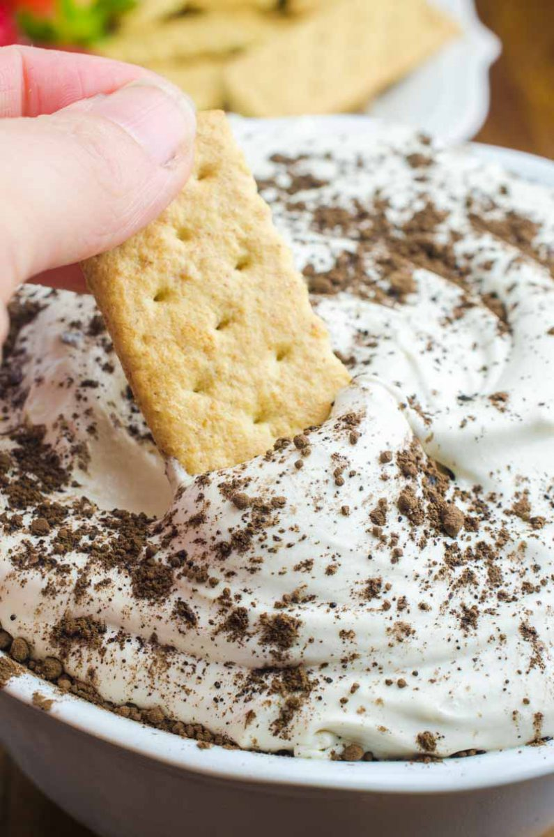 If you are looking for a quick and easy dessert, this Tiramisu Cheesecake Dip is it. It's a creamy, dreamy downright decadent dessert dip for graham crackers and fresh fruit.