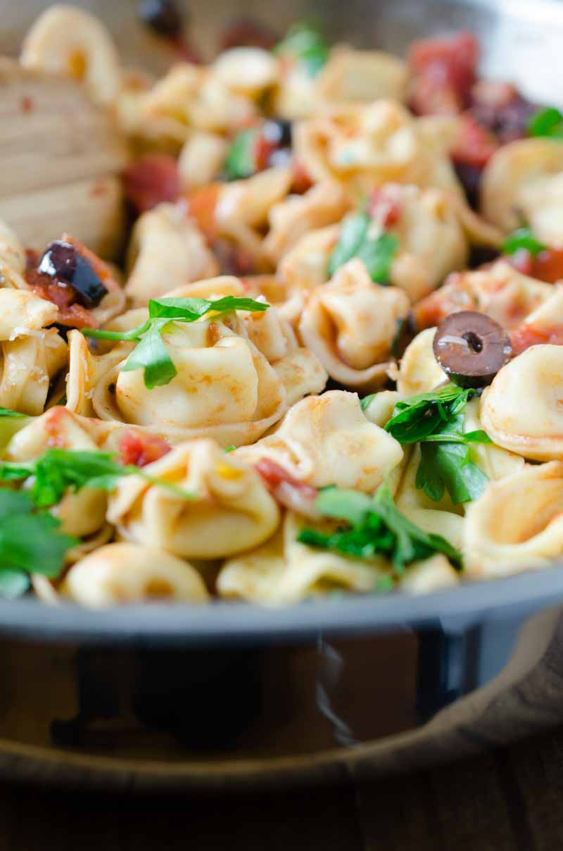 Tortellini Puttanesca is loaded with tomatoes, olives, capers, garlic and red wine. It is a family hit that will make weeknight dinners a breeze!