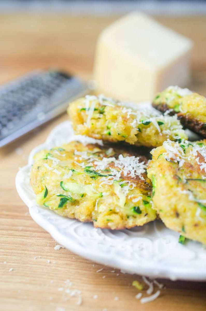 Zucchini cakes made with fresh zucchini, cheese, and spices blended together and fried until golden. A great way to use up that garden zucchini!