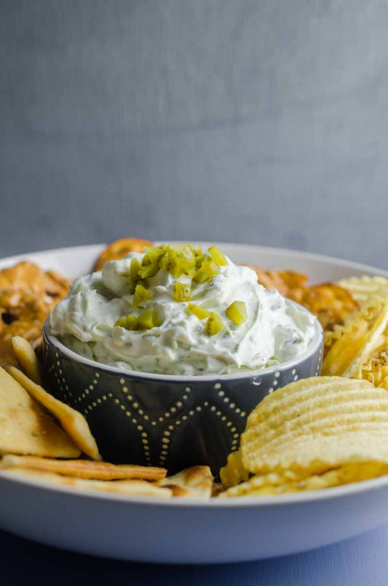 Creamy Dill Pickle Dip is going to be THE dip you'll want to bring to all your summer potlucks. It is super easy to make and a crowd pleaser!