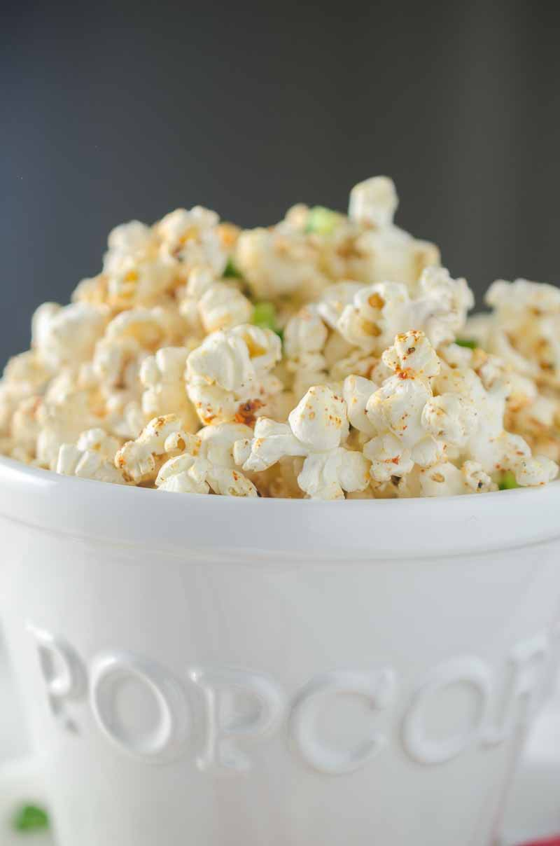 Sweet n' Spicy BBQ Popcorn is the perfect game day snack! Popcorn drizzled with jalapeño butter and sprinkled with BBQ seasoning and a pinch of brown sugar.