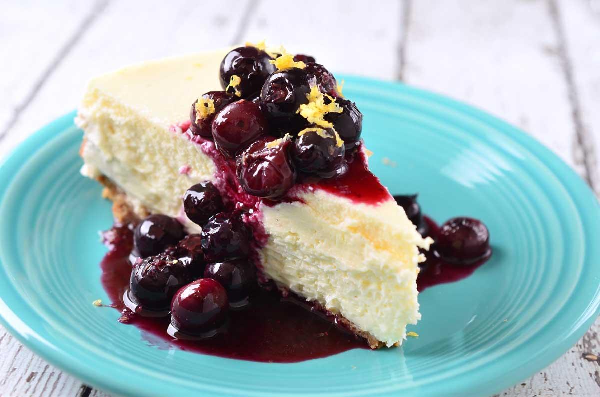 Vanilla Bean Cheesecake with Blueberry Lemon Sauce